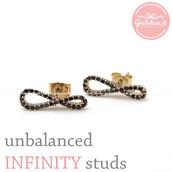 jewels,jewelry,earrings,stud earrings,unbalanced,black crystals earrings,infinity,infinity earrings,infinite,prom earrings,eternity earrings