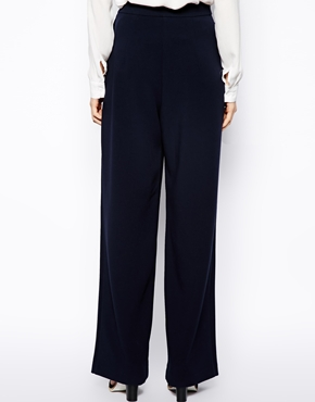 ASOS   ASOS - Pantaloni a vita alta con fondo ampio su ASOS