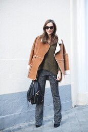 lady addict,blogger,knitted sweater,shearling jacket,knitwear,coat,sweater,shoes,sunglasses,jewels,brown shearling jacket,brown jacket,green sweater,black backpack,backpack,grey pants,flare pants,winter outfits,winter jacket,camel shearling coat