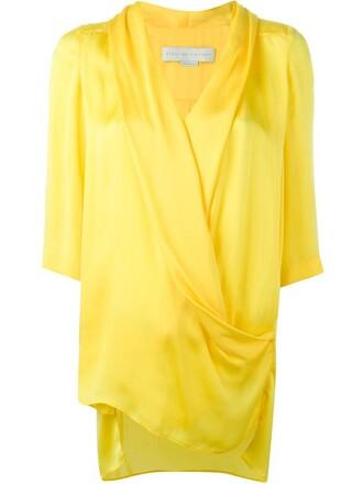 shirt draped yellow orange top
