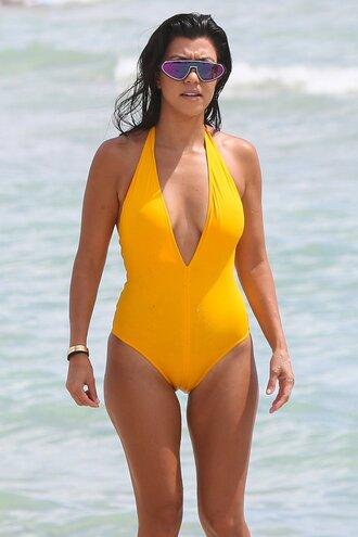 swimwear yellow sunglasses summer sea kourtney kardashian one piece swimsuit beach