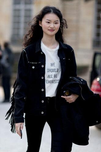 t-shirt feminist feminist tshirt equality quote on it white t-shirt jacket black jacket fringes fringed jacket denim jeans black jeans streetstyle fashion week 2017 shirt