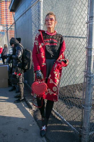 coat nyfw 2017 fashion week 2017 fashion week streetstyle red coat floral floral coat sweater black sweater tights opaque tights boots black boots ankle boots stars gloves bag red bag heart