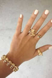 jewels,jewelry,gold,ring,gold ring,bracelets,gold jewelry,gold bracelet,h&m,skull,claws,skull ring,gold midi rings,knuckle ring,claw ring