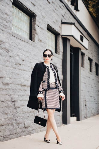 hallie daily blogger jacket skirt coat bag sunglasses jewels sweater fall outfits black coat chanel bag chanel pointed toe pumps tweed jacket