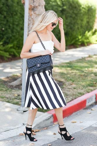 modern ensemble blogger top skirt shoes sunglasses bag chanel black bag shoulder bag white top strapless stripes black and white black heels lace up heels