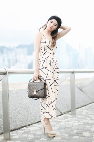 brown platform blogger jumpsuit geometric louis vuitton bag classy platform high heels turban