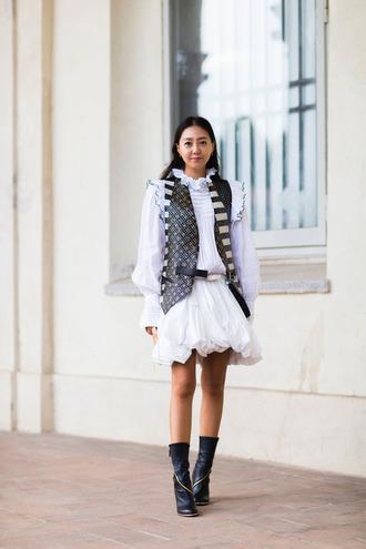 dress fashion week street style fashion week 2016 fashion week milan fashion week 2016 white dress mini dress vest louis vuitton long sleeves ruffle ruffle dress long sleeve dress boots black boots streetstyle