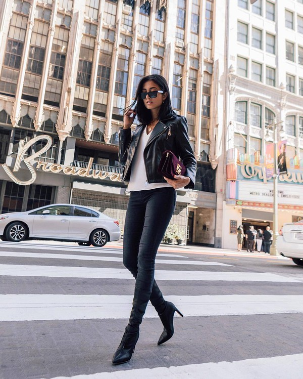 jeans skinny jeans black jeans high heels boots sock boots white t-shirt leather jacket biker jacket clutch sunglasses earrings