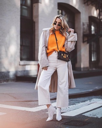 sweater orange sweater pants white pants cropped pants culottes white boots coat boots ankle boots trench coat