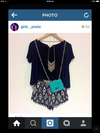 bag black and white pattern with black tassels black top gold chain necklace small over shoulder bag mint colour shorts jewels blouse