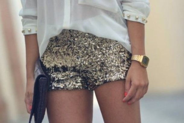 Glitter shorts with a color trending shirt such as this one in snorkel blue make for a very fashion-forward outfit this spring. Tuck your shirt into your waistband to show off those shorts .