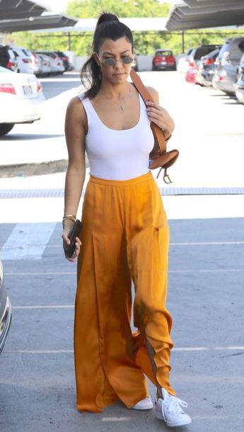 c57ab4a52f4a top, orange, white tank top, wide-leg pants, sneakers, kardashians ...