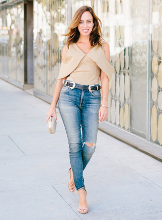 sydne summer's fashion reviews & style tips blogger jeans belt bag jewels shoes nude top beige top skinny jeans ripped jeans clutch nude heels beige cut out shoulder double buckle belt sandals sandal heels high heel sandals spring outfits
