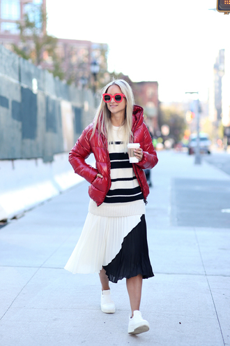 the fashion guitar blogger red jacket down jacket red sunglasses black and white skirt black and white striped sweater hooded jacket stripes pleated skirt pleated jacket skirt sunglasses