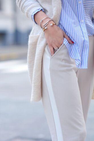 jewels bracelets tumblr stacked bracelets stacked jewelry cuff bracelet jewelry silver jewelry gold jewelry pants grey pants side stripe pants cardigan shirt blue shirt stripes striped shirt