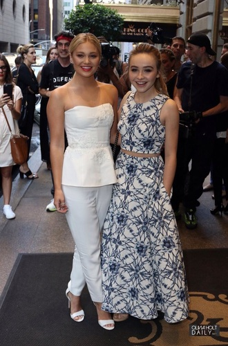 top olivia holt sabrina carpenter fashion week new york fashion week nyfw nywf2015 skirt two-piece 2015nyfw new york city white strapless pants white top white pants blue white and blue skirt white and blue top high neck low neck heels pockets disney channel disney long skirt fashion week 2015 blue shirt low neck line disney channel australia crop tops boob top shoes jumpsuit floral 2 piece prom dress 2 piece dress set floral dress