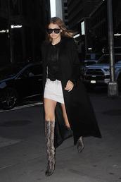 skirt,gigi hadid,gigi hadid style,model,celebrity,celebrity style,top,black top,mini skirt,white skirt,cool,black coat,sunglasses,black sunglasses,boots,knee high boots,animal print