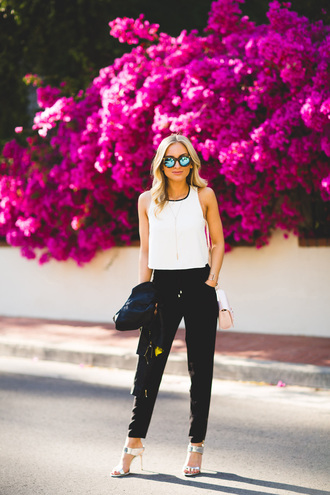 angel food blogger jumpsuit jacket shoes bag white top black pants round sunglasses white heels silver shoes sandal heels silver sandals
