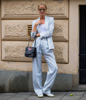 pants,stockholm fashion week,streetstyle,blue pants,blazer,light blue,blue blazer,sneakers,power suit,two piece pantsuits,bag,sunglasses