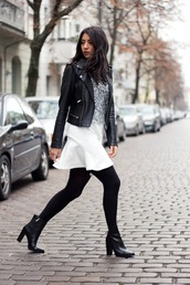 le fashion,blogger,sweater,white skirt,lace top,leather jacket,black boots,opaque tights,mini skirt,black leather jacket,boots,high heels boots,mini skirt and ankle boots