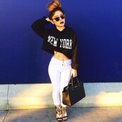 sweater,new york city,black,hoodie,crop tops,cropped sweater,black and white,shoes,shirt,copped jumper,black jumper,white writing,hoodie ny cropped crop jumper,top,white,jeans,pants,bag,heela,gold,denim,handbag,sunglasses,lipstick,jacket,cropped hoodie,bun,make-up