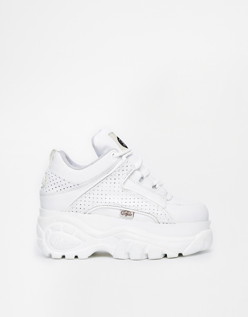 Buffalo Perforated White Flatform Trainers at asos.com