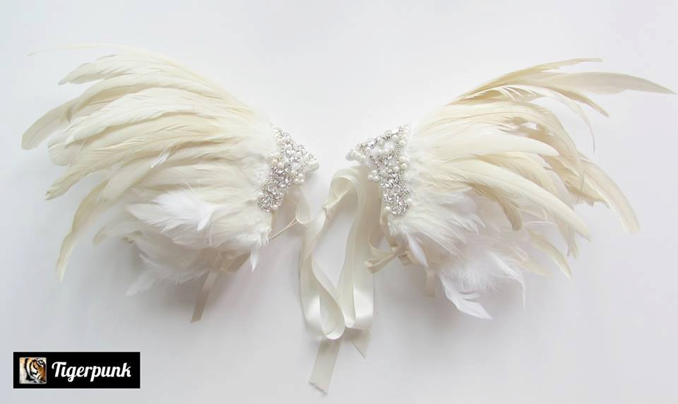 Jewelled feather shoulder pieces