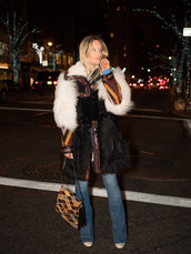 the fashion guitar,blogger,fur coat,flare jeans,shoulder bag,70s style,winter coat,chloe faye bag,printed bag,purse,winter outfits,streetstyle,trendy,big fur coat,black coat,blue jeans,chloe,chloe bag,printed fur coat