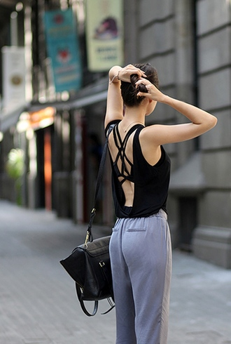 top black open back top sexy top grey pants black bag blogger date outfit