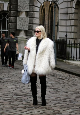 maisie ivy blogger thigh high boots fuzzy sweater fluffy fashion week 2015 coat skirt bag shoes sunglasses big fur coat white coat over the knee boots black boots over the knee black sunglasses streetstyle bag accessoires grey bag white fur coat