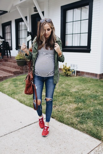 shoes striped shirt army green jacket brown bag ripped jeans new balance sneakers blogger sunglasses