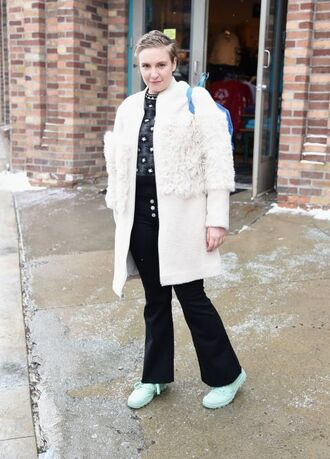 coat lena dunham celebrity celebrity style actress white coat winter coat fur coat sneakers blue sneakers pants flare pants black pants shirt printed shirt