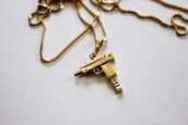 jewels,necklace,gold,gold chain,gun,machine gun,style,tumblr,tumblr outfit,chain,dope,uzi