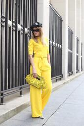 from brussels with love,blogger,jumpsuit,shoes,bag,yellow jumpsuit,clutch,spring outfits,hat