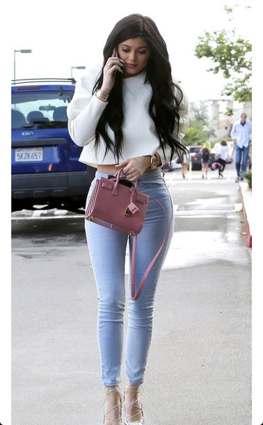 bag mauve klyie jenner faux leather shirt kylie jenner jeans blouse kylie jenner grey white blouse jacket white crop tops white heels long sleeve crop top bright blue jeans blue skinny jeans