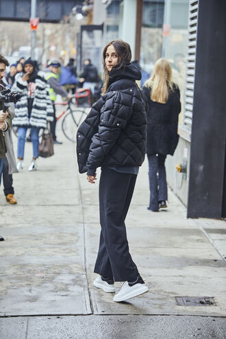 jacket nyfw 2017 fashion week 2017 fashion week streetstyle pants black pants wide-leg pants puffer jacket black jacket sneakers ysl white sneakers low top sneakers hoodie black hoodie