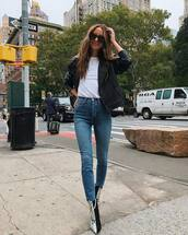 jeans,skinny jeans,high waisted jeans,ankle boots,snake print,white t-shirt,jacket,biker jacket,sunglasses,earrings