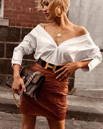 skirt leather skirt brown skirt white shirt shirt belt bag mini skirt off the shoulder off the shoulder top