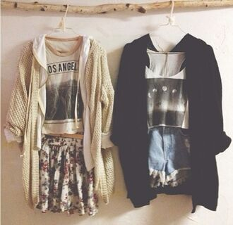 brandy melville graphic tee moon phases printed t-shirt knitted cardigan outfit idea floral skater skirt distressed denim shorts black cardigan vintage outfit tumblr soft grunge summer outfits los angeles