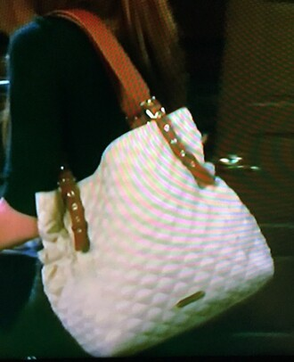bag cream quilted baby bag with leather straps cream colored quilted tote bag-- could be a diaper bag-- was seen in days of our lives carried by si
