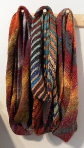 scarf,brown,orange,grey,tan,knitted scarf,warm/earthtone,earth tones,blue,light blue,rustic,black,yellow,beige,red,green,olive green,olive green scarf,three,scarve,white crop tops,infinity,infinity scarf,infinite scarf,indie,boho,bohemian