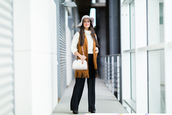 jewels,jacket,suede jacket,fringed jacket,shoulder bag,hat,white sweater