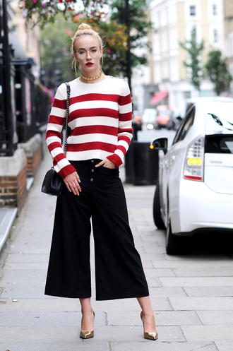 sweater fashion week street style fashion week 2016 fashion week london fashion week 2016 culottes black culottes black pants pants cropped pants stripes striped sweater bag black bag glasses pointed toe pumps pumps gold pumps choker necklace necklace gold necklace fall outfits streetstyle red lipstick