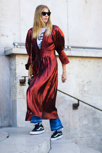 dress fashion week street style fashion week 2016 fashion week paris fashion week 2016 red dress midi dress v neck v neck dress denim jeans blue jeans sneakers vans black sneakers dress over pants sunglasses streetstyle satin dress