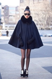 coat,black,black code,black sunglasses,sunglasses,bun,fur,faux fur,faux fur coat,cape,Black cape,poncho,elegance,chic,top knot bun