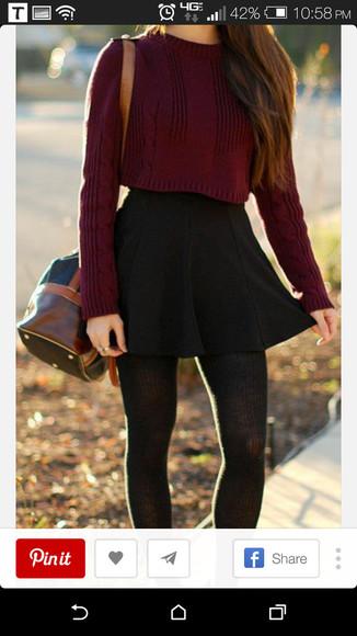 red sweater black skirt bag
