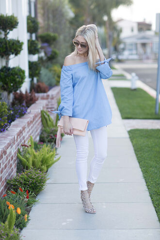 modern ensemble blogger blouse bag blue top off the shoulder long sleeves white jeans skinny jeans nude bag clutch lace up heels nude heels