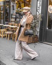 coat,light brown,wool coat,oversized,black bag,wide legged pants,baker boy hat