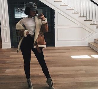 coat kylie jenner black leggings white top brown jacket snapback